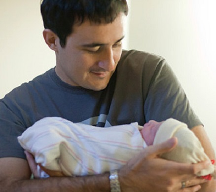 father-holding-newborn